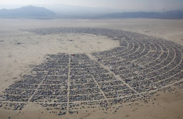 U.S Government Butting Heads with Burning Man Over Barriers, Lasers & Trash cans